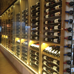 Wooden racking and a glass front for elegant wine wall
