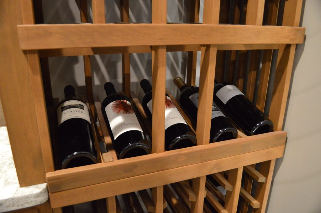 Display Row Wooden Wine Racks Utilized in Custom Wine Cellar Project in Richmond