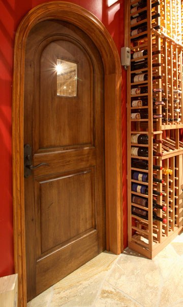 Arched Wooden Wine Cellar Door by Washington DC Builders