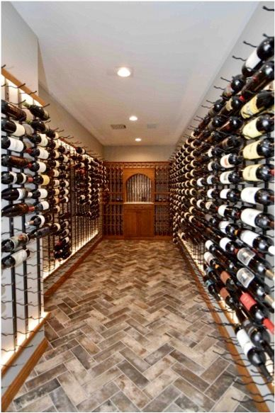 Metal wine racks in a contemporary residential wine cellar