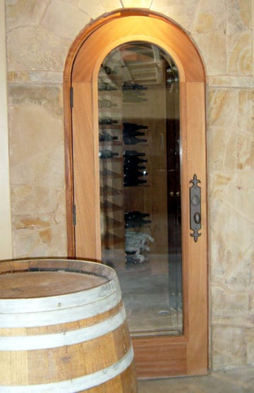 Arched Glass Wine Cellar Door with Wooden Frame: an In-Demand Door Style in Baltimore